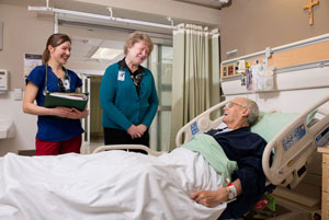 Nurses talking with patient